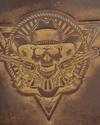 Cowboy Skull with Guns Triangle Embossed Genuine 100% Leather Wallets are hand made in the USA using Distressed Heavy Chrome Oil Tanned Crazy Horse Leather.
