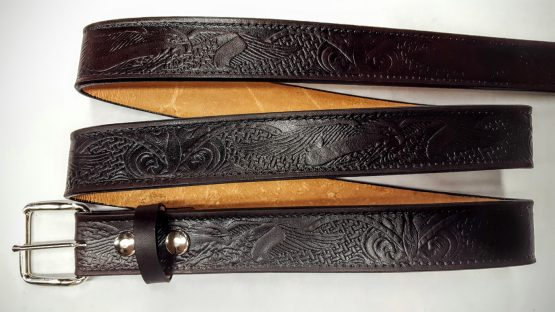 These belts are 100% Solid Leather Made in the USA. All our Hand Made belts are heavy 8/9 or 9/10 oz. weight