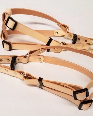 These are 100 % Leather Dog Harness made in the USA. We have used beautiful natural color 5/6 oz. weight Veg. tanned leather, a bit on the firm side. We use heavy duty Steel hardware and steel rivet with caps. Size is adjustable up to 26 Inches.