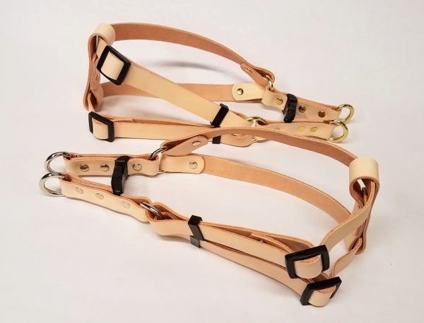 These are 100 % Leather Dog Harness made in the USA.We have used beautiful natural color 5/6 oz. weight Veg. tanned leather, a bit on the firm side. We use heavy duty Steel hardware and steel rivet with caps.Size is adjustable up to 26 Inches.